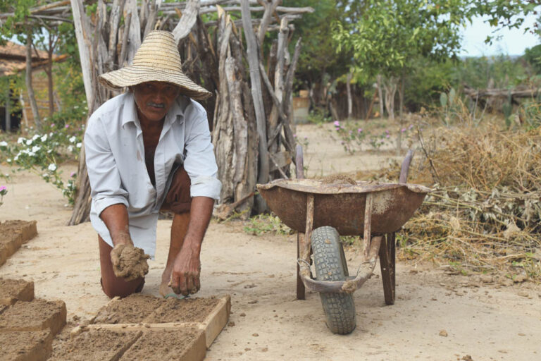 A Baixões resident making adobe to build his home.